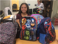 Junior Donates Backpacks and School Supplies photo